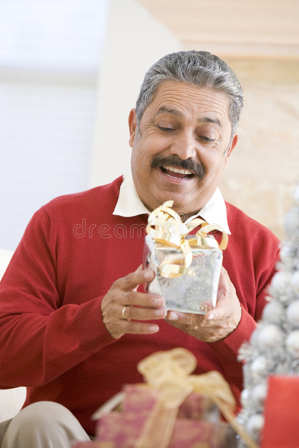 Man Excited To Open Christmas Present.  royalty free stock photo