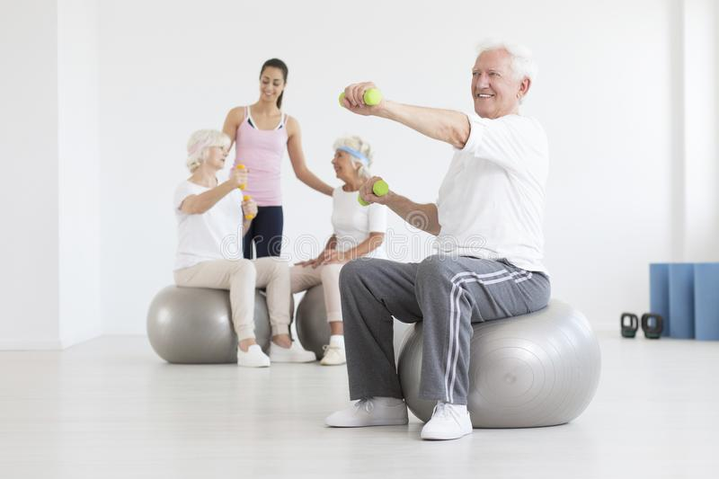 Man on exercise ball royalty free stock images