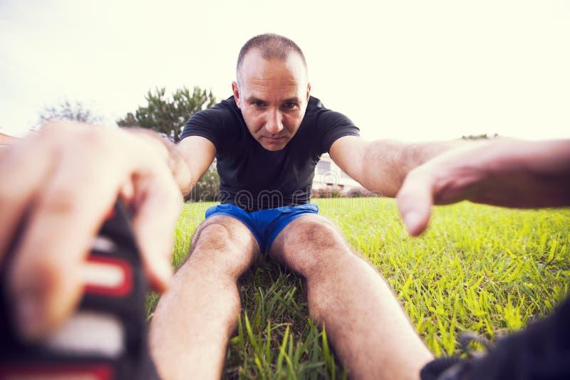 Man exercise. Mature man exercise in a city park stock photos