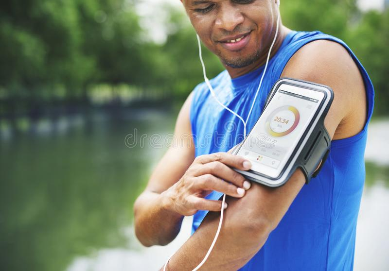 Man Exercise Outdoos Nature Park Health Tracking Concept stock image