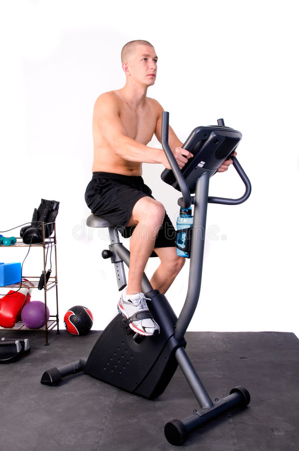 Man on Exercises Bike royalty free stock photography