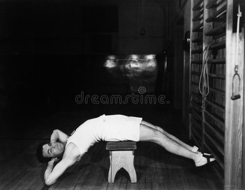 Man exercising on bench royalty free stock photo