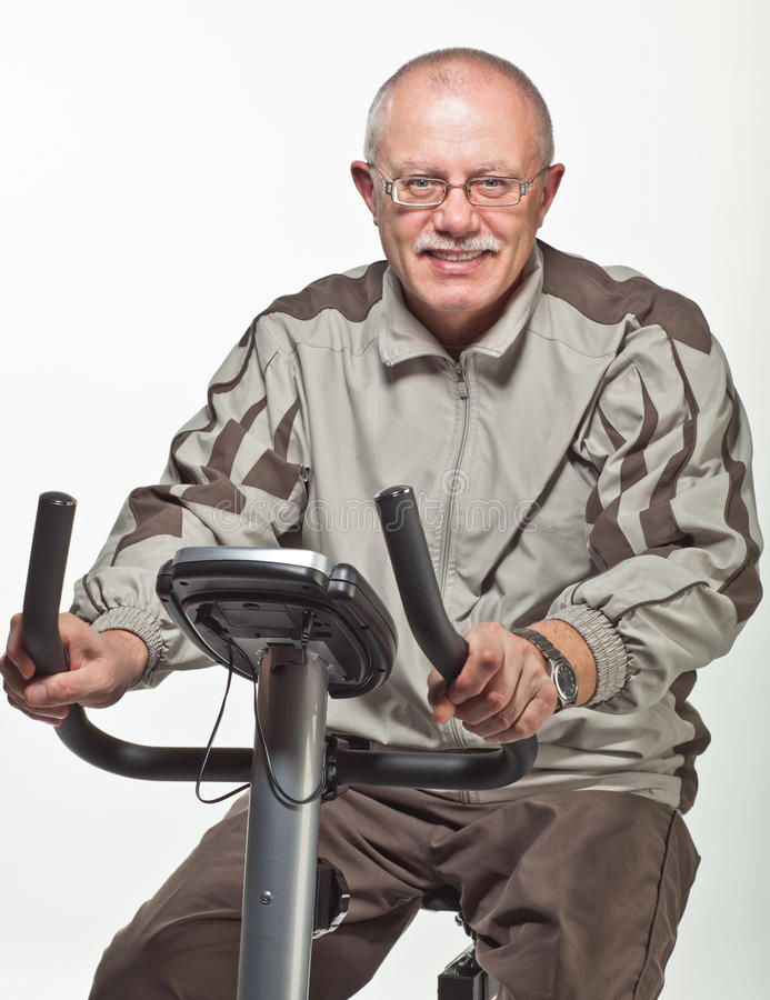 Download Man Exercising On A Bicycle Trainer Royalty Free Stock Image - Image: 22132416