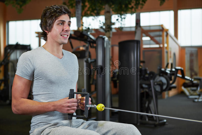 Download Man Exercising On Cable Machine Stock Image - Image: 27865637