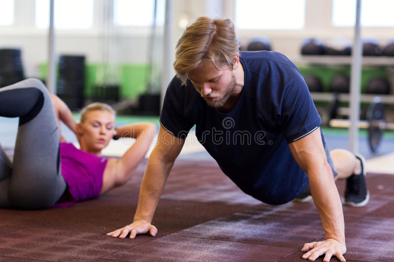 Man exercising and doing straight arm plank in gym stock photography