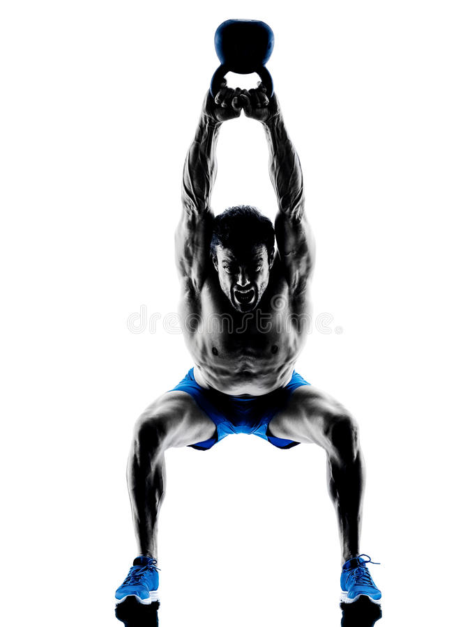 Man exercising fitness Kettle Bell weights royalty free stock photography