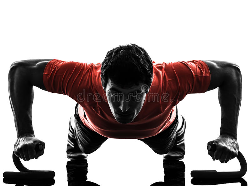 Man exercising fitness workout push ups silhouette stock photography
