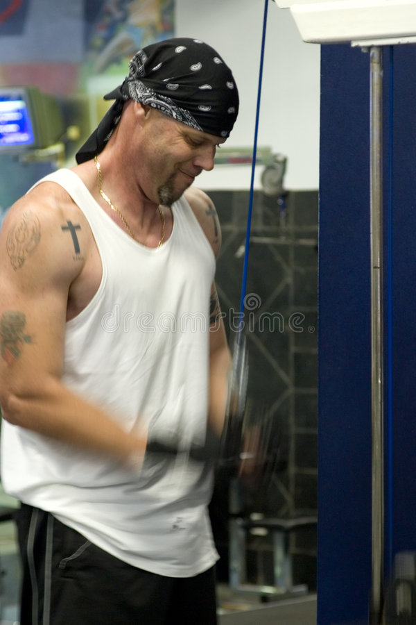 Man exercising in gym royalty free stock images