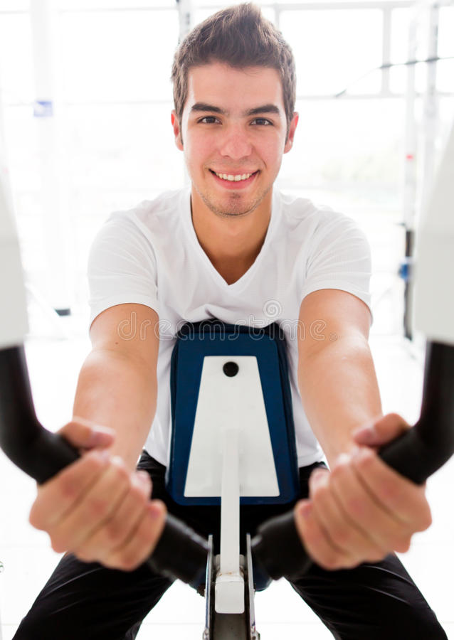 Download Man exercising at the gym stock image. Image of workout - 25849165