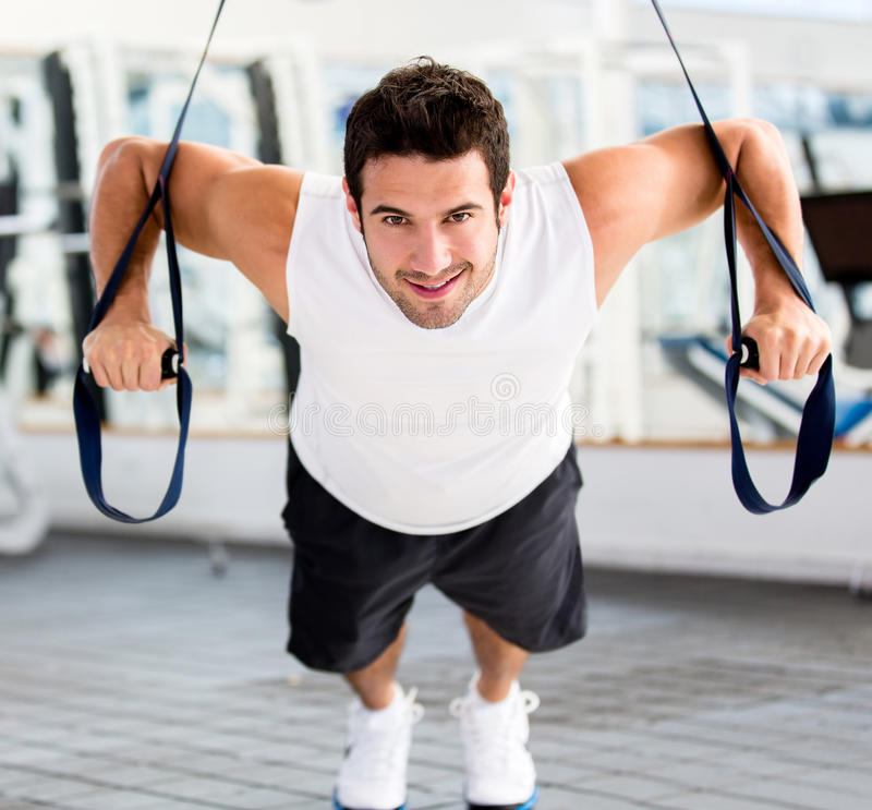 Download Man exercising at the gym stock image. Image of attractive - 25994081