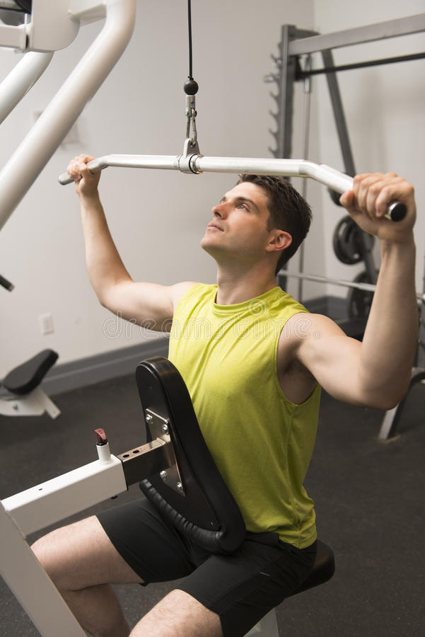 Download Man Exercising In Health Club Stock Photo - Image: 32429866