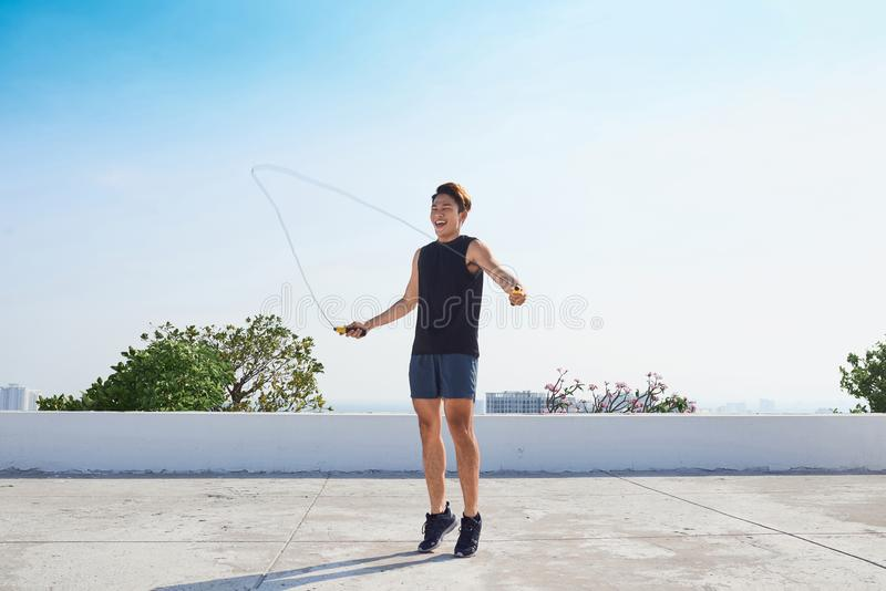 Man exercising with jump-rope outdoors royalty free stock photos