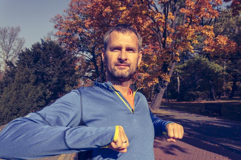 Man exercising in the park in autumn royalty free stock images