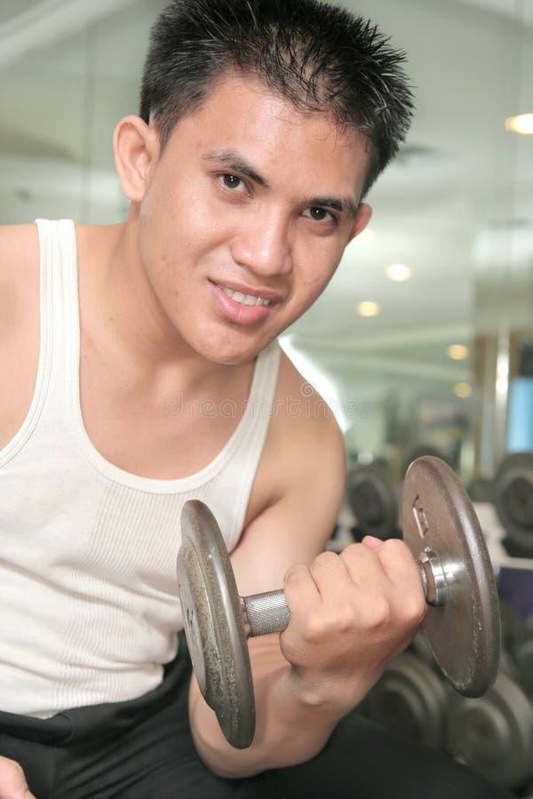 Man exercising smiling