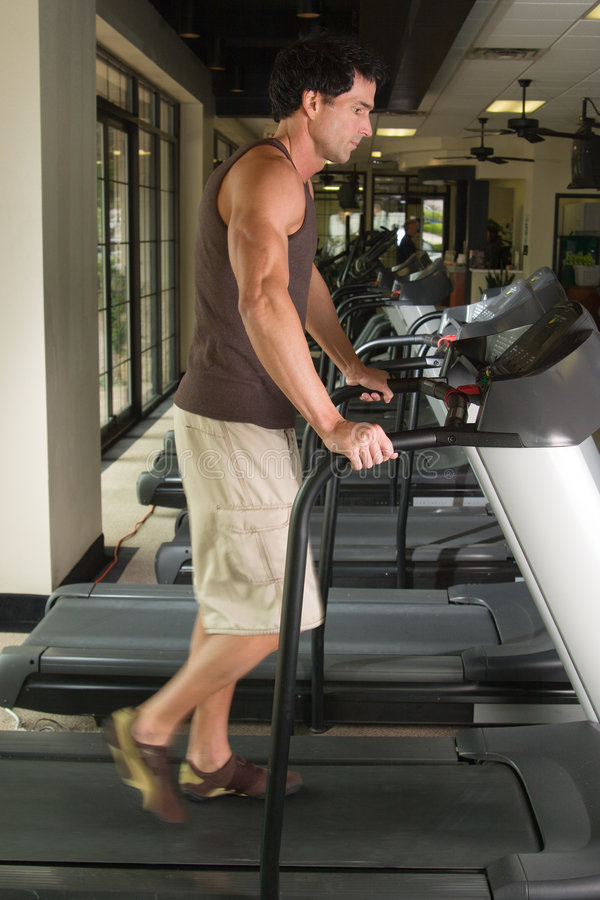 Download Man Exercising On Treadmill 3 Stock Photo - Image: 2464544