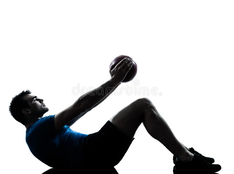 Man exercising workout holding fitness ball posture. One caucasian man exercising workout holding fitness ball posture in silhouette studio isolated on white stock images