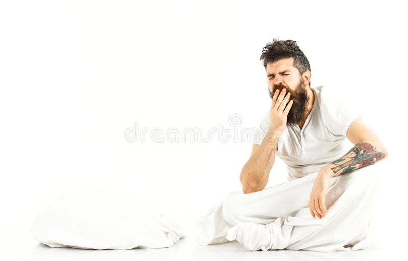 Man exhausted, needs relax, rest, nap, copy space. Sleepy yawning concept. Sleepy bearded man on white background. Hipster with beard and mustache fall asleep royalty free stock photo