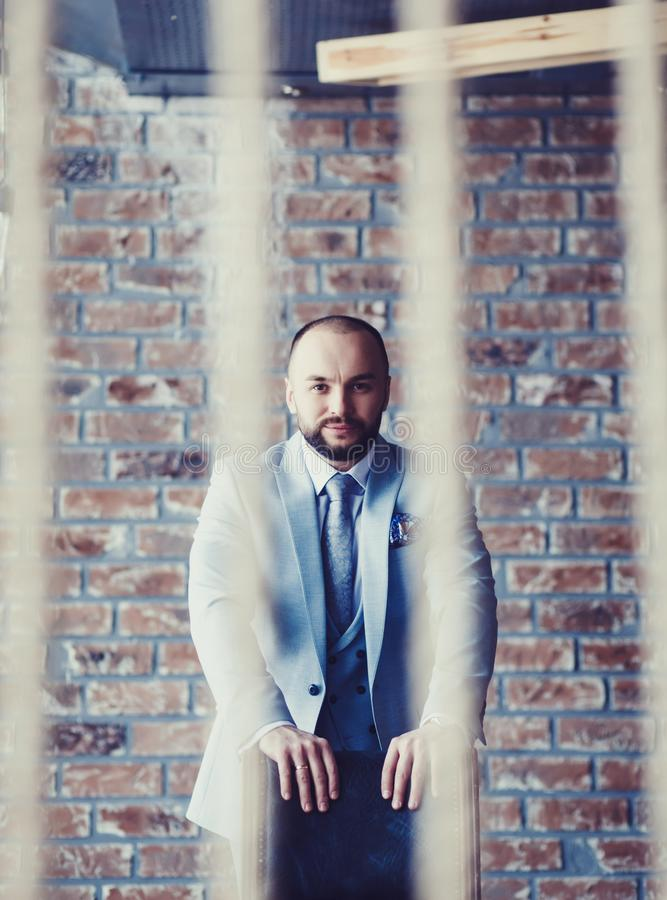 Man in expensive custom tailored suit stock photo