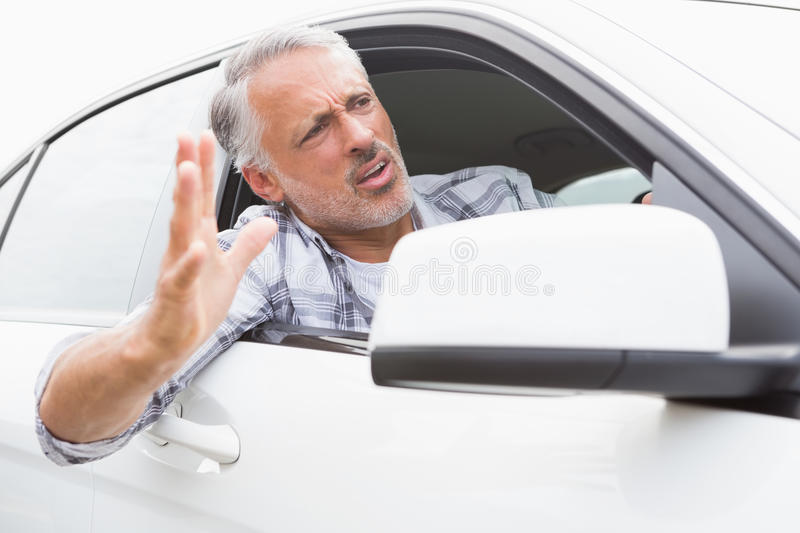 Man experiencing road rage. In his car royalty free stock photos