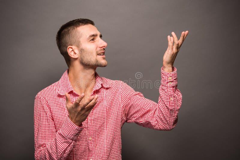 Man explaining something in studio stock images
