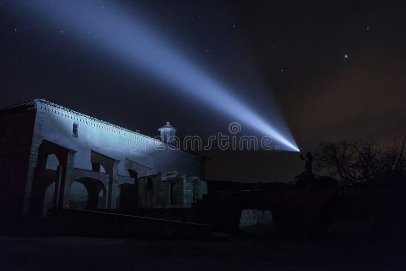 Man exploring church at night royalty free stock image