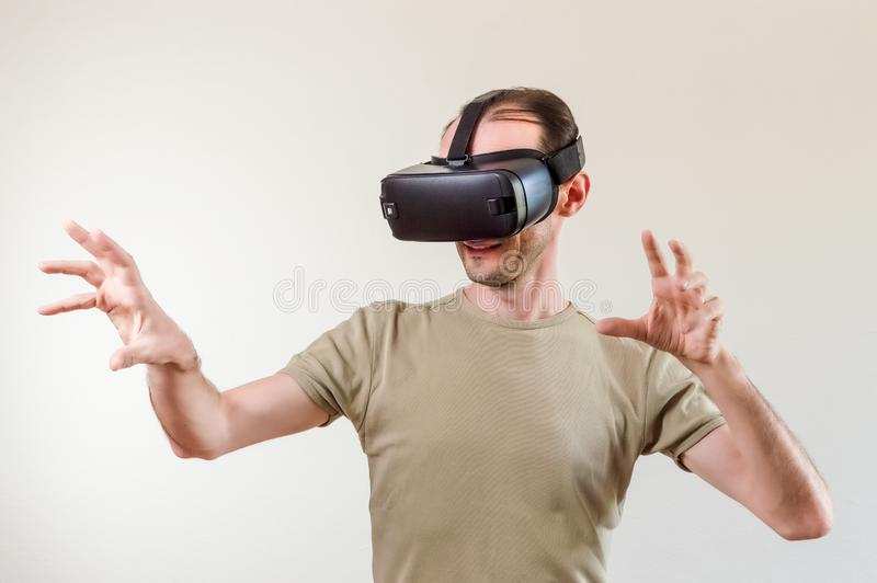 Man exploring modern technology virtual reality with head mounted display on white background royalty free stock photo