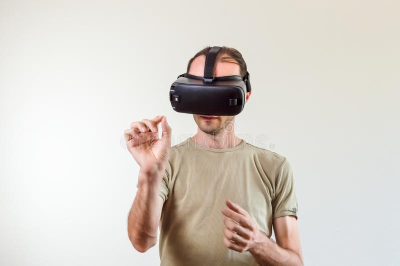 Man exploring modern technology virtual reality with head mounted display on white background royalty free stock image