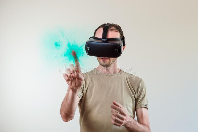 Man exploring modern technology virtual reality with head mounted display on white background stock images
