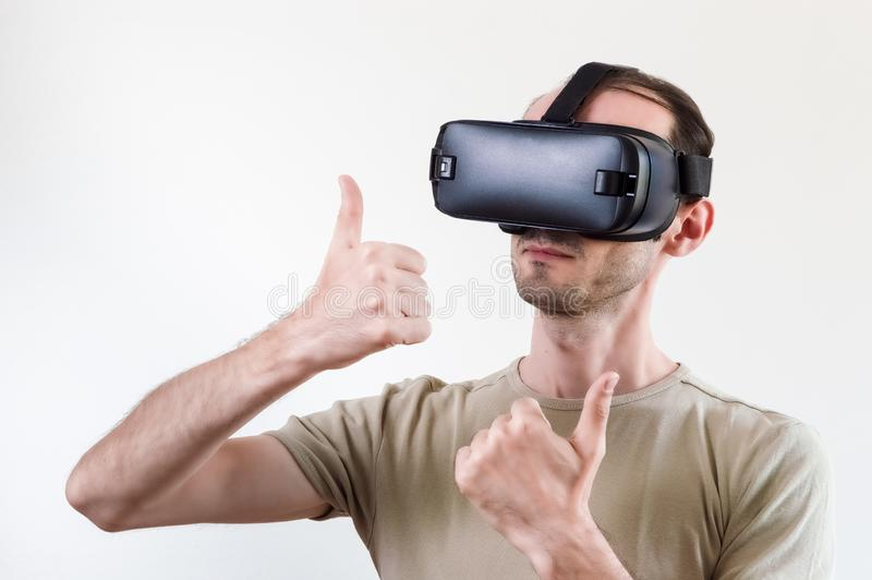 Man exploring modern technology virtual reality with head mounted display on white background stock image