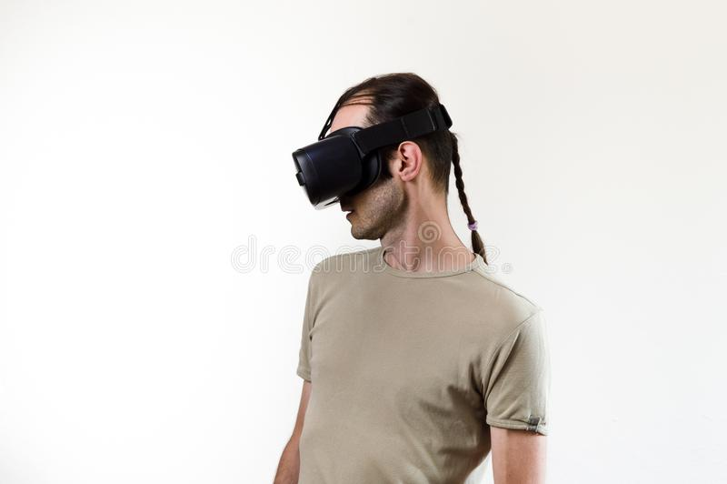 Man exploring modern technology virtual reality with head mounted display on white background royalty free stock images