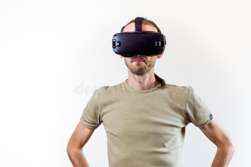 Man exploring modern technology virtual reality with head mounted display on white background stock photo