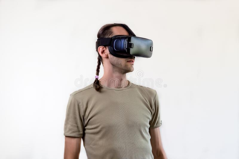 Man exploring modern technology virtual reality with head mounted display on white background stock photos