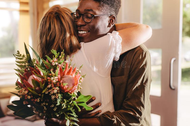 Man expressing his love for his girlfriend on date stock photo