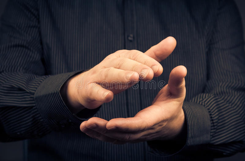 Man expressing their appreciation clapping hands royalty free stock images