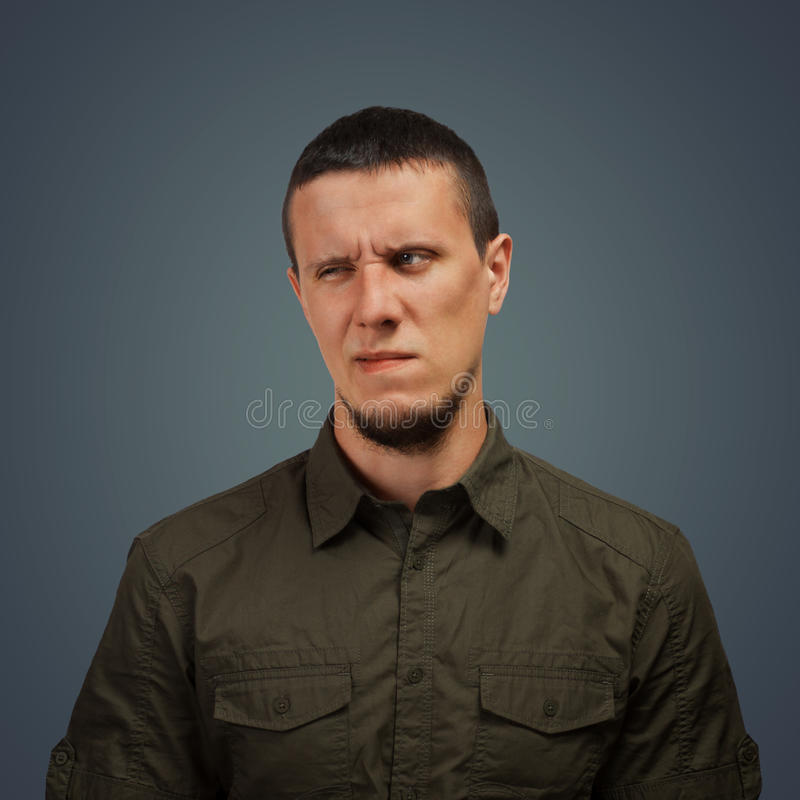 Man with an expression of disgust royalty free stock photography