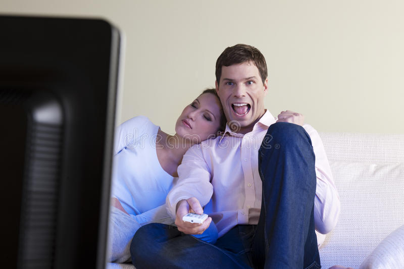 Download Man exulting watching tv stock photo. Image of indoors - 13830260