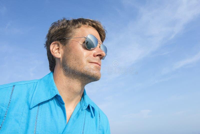 Man with eyes on the sea stock photos