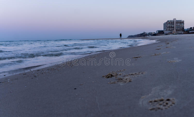 Man is eying in the morning in Herzliya. MorningView of Herzliya`s SeeView at 6am stock photography