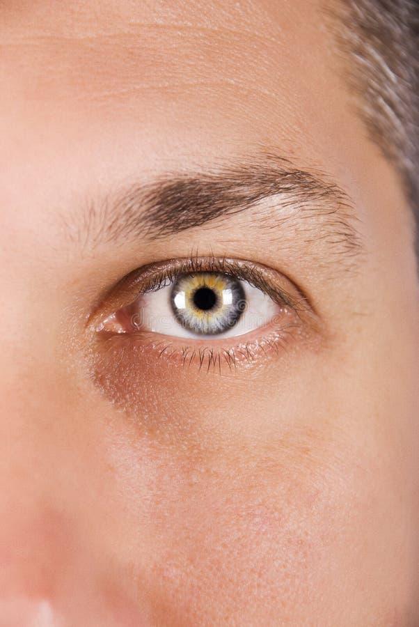 man för blått öga arkivbild