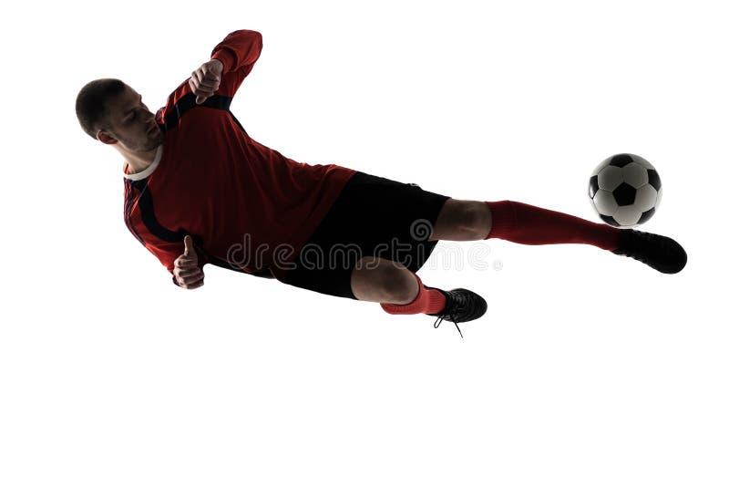 Man för fotbollspelare som spelar att sparka i konturn som isoleras på vit bakgrund royaltyfri fotografi