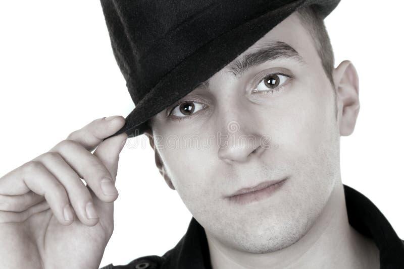 man för svart hatt fotografering för bildbyråer