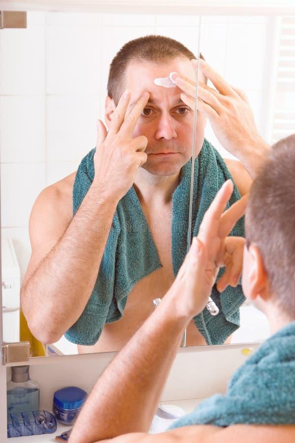 Man face creams stock photos