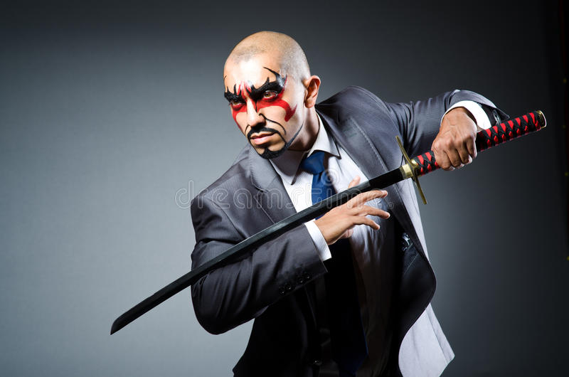 Man with face paint. And sword stock images