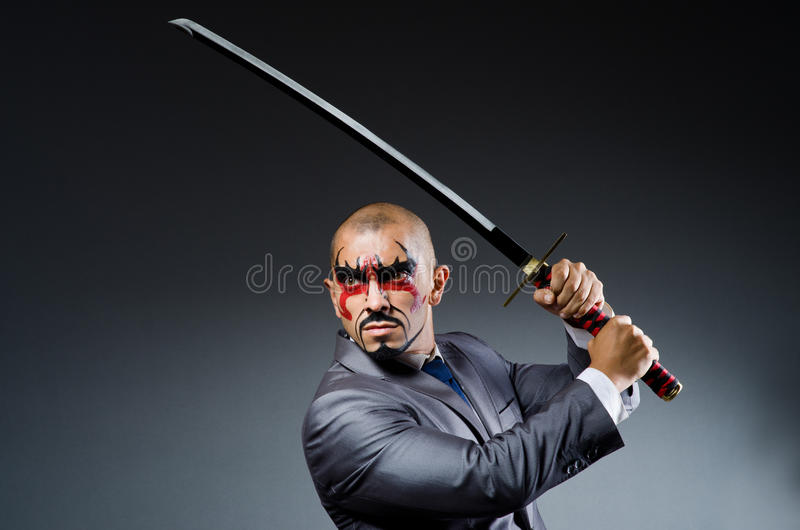 Man with face paint. And sword stock image