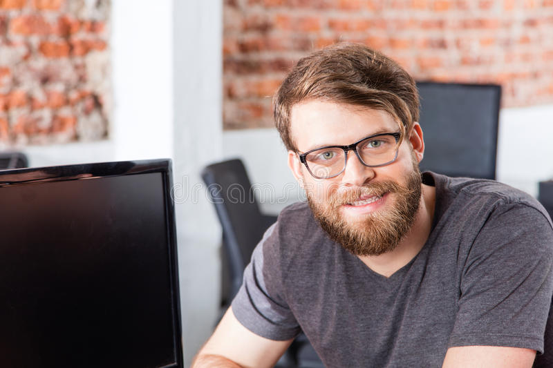 Man face sitting office smile, Casual businessman. Beard glasses royalty free stock photography