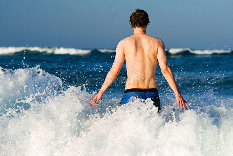 Man facing the ocean royalty free stock images
