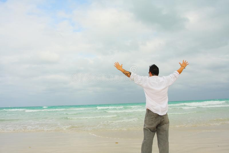 Man Facing The Ocean stock photos