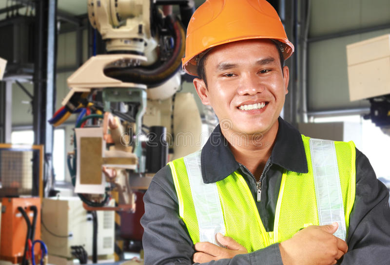 Man factory engineer or worker with robot machine royalty free stock photos