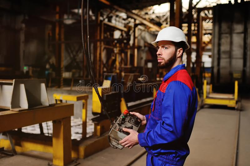 Man, factory, remote control in hands royalty free stock photos