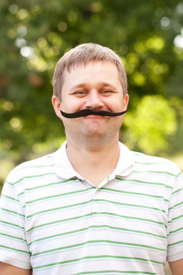 Man with fake mustache royalty free stock images
